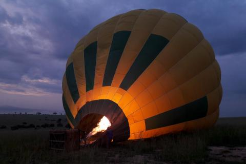 Inflating the hot-air balloon before sunrise (Murchison Falls, Uganda)